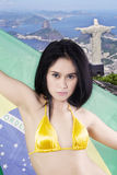 Pretty young woman with Brazilian flag Stock Images