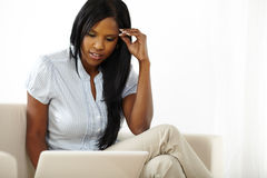 Pretty young woman browsing on laptop Royalty Free Stock Photo