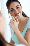 Pretty young woman brushing her teeth. Stock Photos