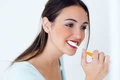 Pretty young woman brushing her teeth. Portrait of pretty young woman brushing her teeth stock images