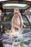 Pretty young woman buying groceries in a supermarket Royalty Free Stock Image