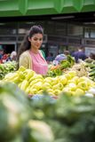 Pretty young woman buying vegetables Royalty Free Stock Images