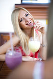 Pretty young woman in a cafe Stock Photos