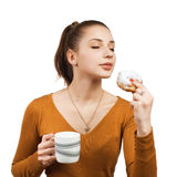 Pretty young woman with cake and milk Royalty Free Stock Images