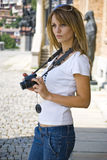 Pretty young woman with camera stock photos