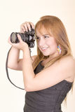 Pretty young woman with camera Royalty Free Stock Photos