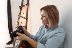 Pretty young woman with camera Stock Photo