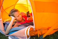 Pretty, young woman camping outdoors Stock Photography