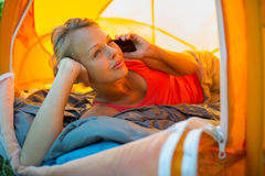 Pretty, young woman camping outdoors Royalty Free Stock Images