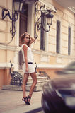 Pretty young woman with the car key in her hand stock photo