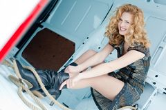 Pretty young woman in cargo van Royalty Free Stock Image