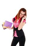 Pretty young woman carrying books. Stock Photo