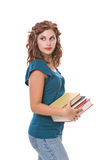 Pretty young woman carrying books. Pretty young woman, isolated against white background, carries books to school stock photos