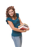 Pretty young woman carrying books. Pretty young woman, isolated  agains  white background, carries books to school Stock Photos