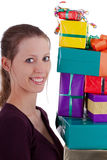 Pretty young woman carrying a lot of gifts Royalty Free Stock Image