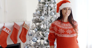 Pretty young woman celebrating Christmas at home Royalty Free Stock Photography