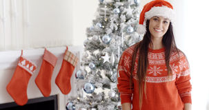 Pretty young woman celebrating Christmas at home Royalty Free Stock Photo