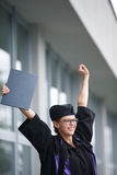 Pretty, young woman celebrating joyfully her graduation Stock Images