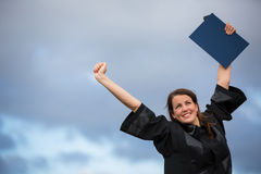 Pretty, young woman celebrating joyfully her graduation Royalty Free Stock Photography