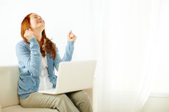Pretty young woman celebrating a success Royalty Free Stock Image