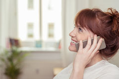 Pretty young woman chatting on her mobile Stock Photography
