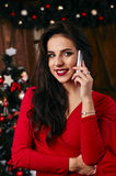 Pretty young woman chatting on her mobile phone in Stock Photography