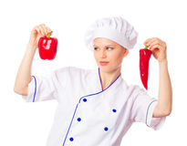 Pretty young woman chef choosing vegetables Royalty Free Stock Photos