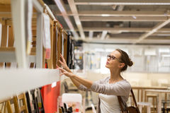 Pretty, young woman choosing the right furniture Stock Photography