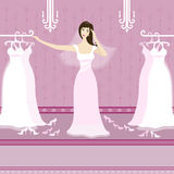 Pretty young woman choosing a wedding dress in the Stock Photos