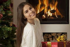 Pretty young woman in Christmas interior Stock Photos