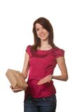 Pretty young woman with Christmas packages Stock Images