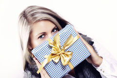 Pretty young woman with christmas present Stock Photo