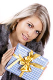 Pretty young woman with christmas present Stock Image