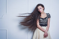 Pretty young woman with closed eyes and long hair Stock Photo