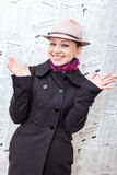 Pretty young woman in coat and hat laughing Royalty Free Stock Images