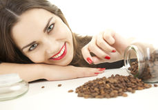 Pretty young woman with coffee beans Royalty Free Stock Photography