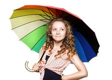 Pretty young woman with color umbrella Stock Image