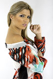 Pretty young woman is a colorful blouse royalty free stock photos