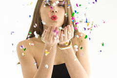 Pretty young woman with confetti Stock Image