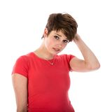 Pretty young woman is confused royalty free stock photography