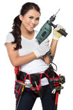 Pretty young woman construction worker Stock Images