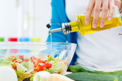 Pretty young woman cooking at home Stock Photography