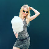 Pretty young woman with cotton candy royalty free stock image