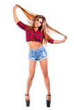 Pretty young woman in a country style clothes. Isolated over white background royalty free stock image