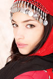 Pretty young woman cover with red scarf royalty free stock photos