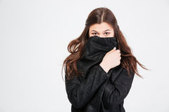 Pretty young woman covered her face with black jacket Stock Photos
