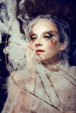 Pretty young woman with creative make up. Close up Stock Image