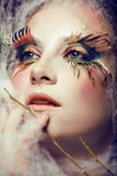 Pretty young woman with creative make up. Close up Royalty Free Stock Photo