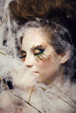 Pretty young woman with creative make up. Close up Royalty Free Stock Images