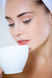 Pretty Young Woman with a Cup of Coffee or Tea Royalty Free Stock Images